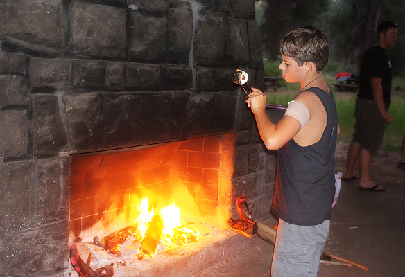 Roasting the perfect marshmallows stuffed with Rolos.