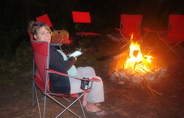 Lindsey enjoying a book by the fire.